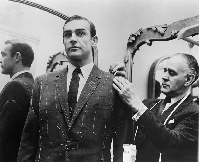 Tailor Anthony Sinclair fitting Scottish actor Sean Connery for one of the suits he will wear in the film 'From Russia With Love', Mayfair, London, 1963. - Getty Images / United Artists